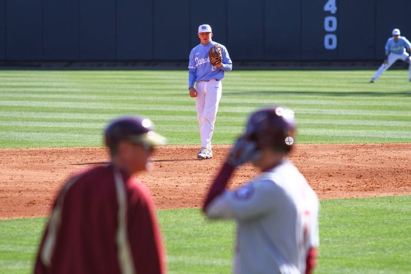 Sophomore Ike Freeman (8) watches as a Florida State coach and player converse on March 23.