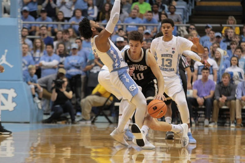 North Carolina guard Joel Berry II (2) defends Wofford guard Nathan Hoover (10) on Dec. 20 in the Smith Center.