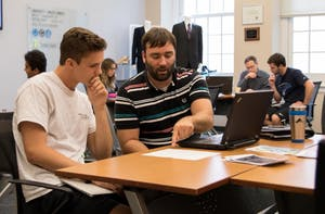 UNC student Trey Sullivan (left) and Assistant Director of Career Services, Jonathan Adams (right), participate in a business school workshop in Hanes Hall Monday afternoon.