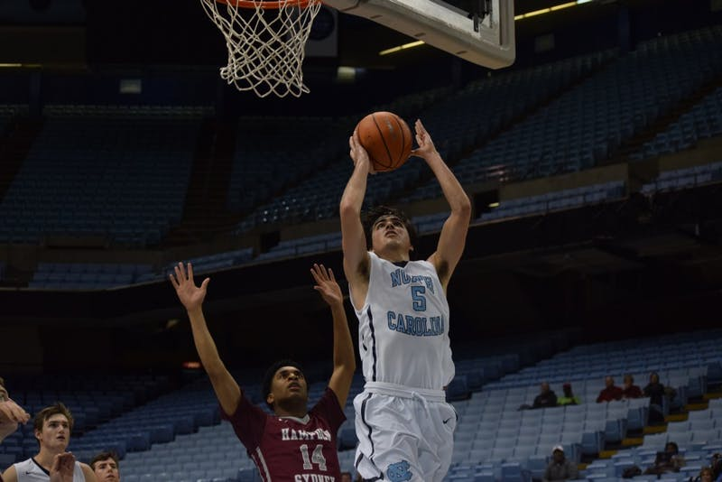 Sophomore guard Robbie O'Han (5) takes a layup against Hampden-Sydney College on Feb. 7 in the Smith Center.