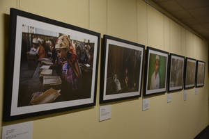 Photos taken by Lynsey Addario in Sittwe, Myanmar are on display in the refugee art exhibit at the Friday Center.