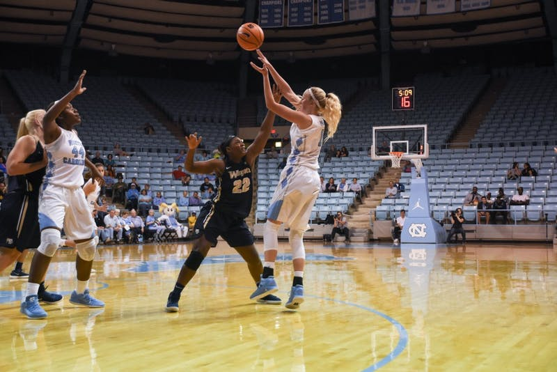 Guard Taylor Koenen (1) shoots against Wingate on Wednesday in Carmichael Arena.