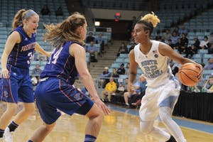 Guard Paris Kea (22) takes on two Presbyterian defenders in a game at Carmichael Arena on Dec. 5.