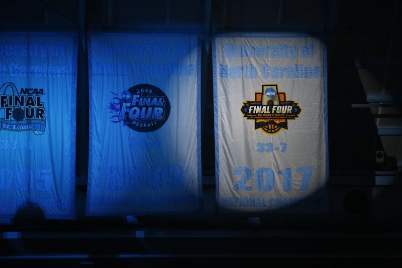 The 2017 NCAA Men's Basketball National Championship banner is revealed in the Dean Smith Center during Late Night With Roy on Friday night.