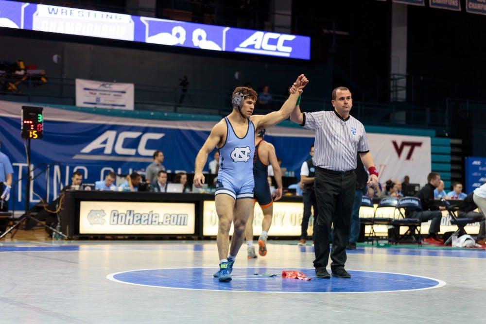 Troy Heilmann, Ethan Ramos take home gold for UNC in ACC Wrestling Championships