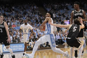 Guard Joel Berry II (2) drives past Wofford defenders for a layup on Dec. 20 in the Smith Center.