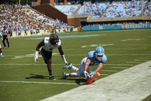 Wide receiver Thomas Jackson reaches for the pylon and scores a touchdown in against California.