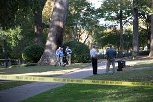 Police investigate an explosion near the Davie Poplar tree in McCorckle Place on Nov. 2.