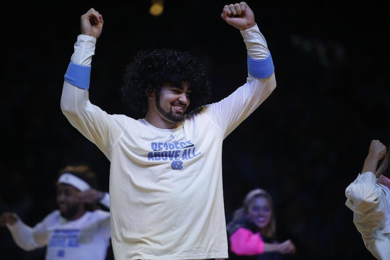 Luke Maye dances in costume at Late Night With Roy on Friday night.