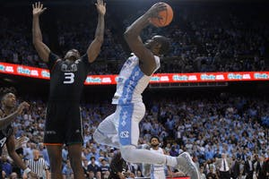 Senior forward Theo Pinson (1) rises up for a shot against Miami on Feb. 27 at the Smith Center.