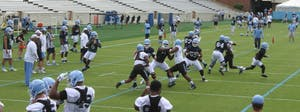 Quarterback Brandon Harris (6) drops back during the North Carolina football team's first practice in Kenan Stadium on Wednesday.
