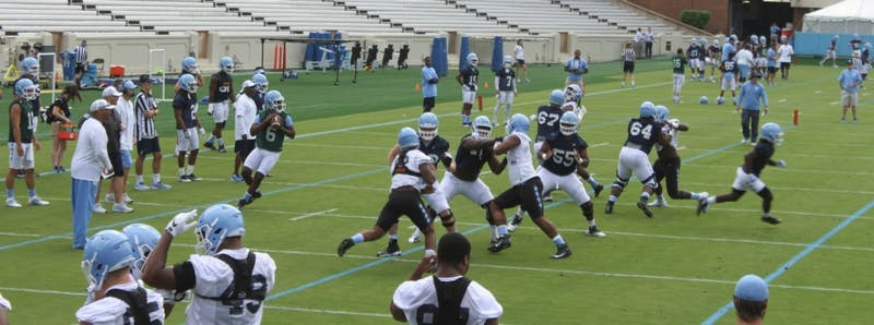 Quarterback Brandon Harris (6) drops back during the North Carolina football team's first practice in Kenan Stadium on Wednesday.