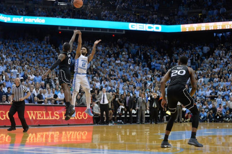 Senior Joel Berry II (2) sinks a game-tying three-pointer to tie the game against Miami in the final seconds on Feb. 27 at the Smith Center.