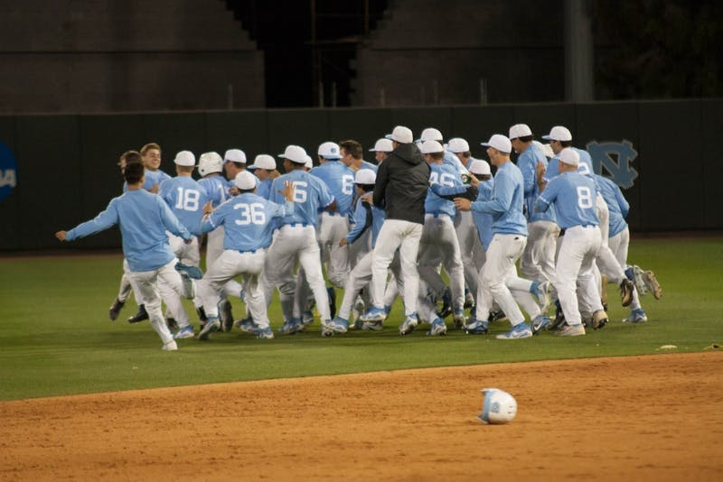 The North Carolina baseball team swarms the field after a walkoff win in the bottom of the 15th inning against Wake Forest on March 30 at Boshamer Stadium.