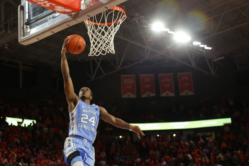 Guard Kenny Williams finishes a fastbreak layup against Clemson on Jan. 3.