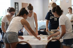 Members Hannah Smith (1st Year), Alex Udell (Junior), Bella Reiss (Junior), Elizabeth Byrd (Junior) and Kenza Araba bake Challah at UNC Hillel on Wed, Sept 27.