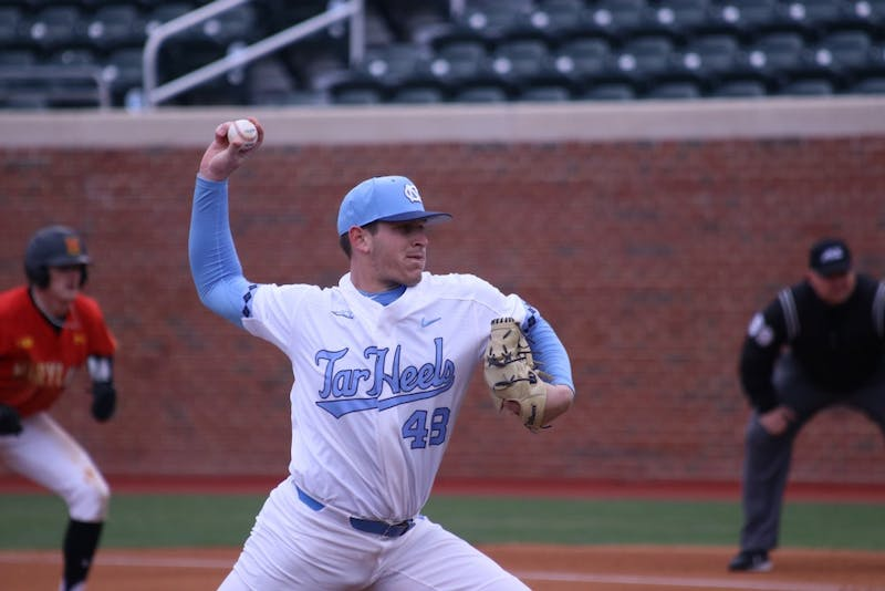 Junior Rodney Hutchison Jr. (48) pitches against Maryland on March 20 in Boshamer Stadium.
