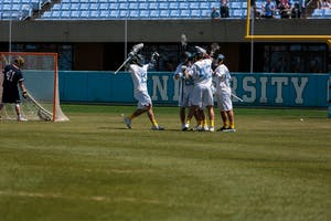 The North Carolina men's lacrosse team celebrates a goal against Notre Dame on April 21 at Kenan Stadium.