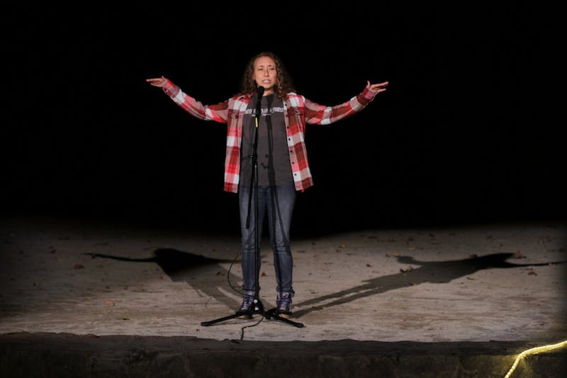 Performer Betsy Bertram tells a story about her late father during the Into the Wild event at the Forest Theater on Friday night.