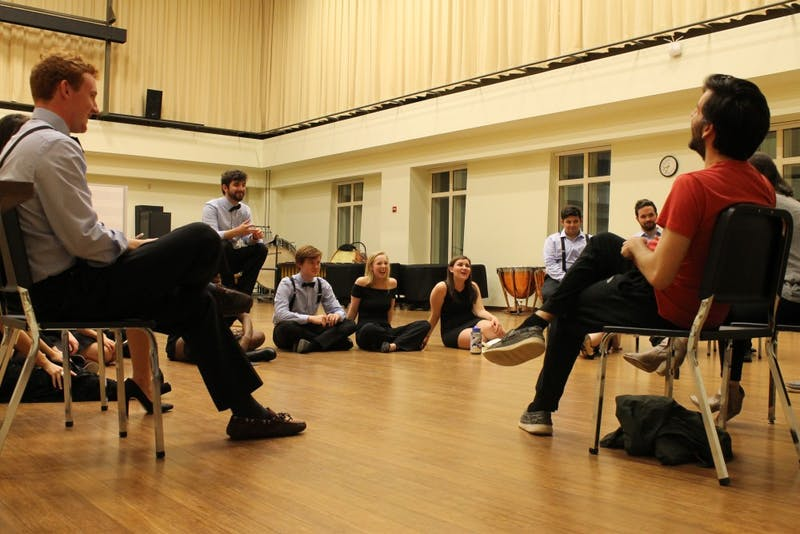 Members of Tar Heel Voices prepare for their upcoming competition at a rehearsal.
