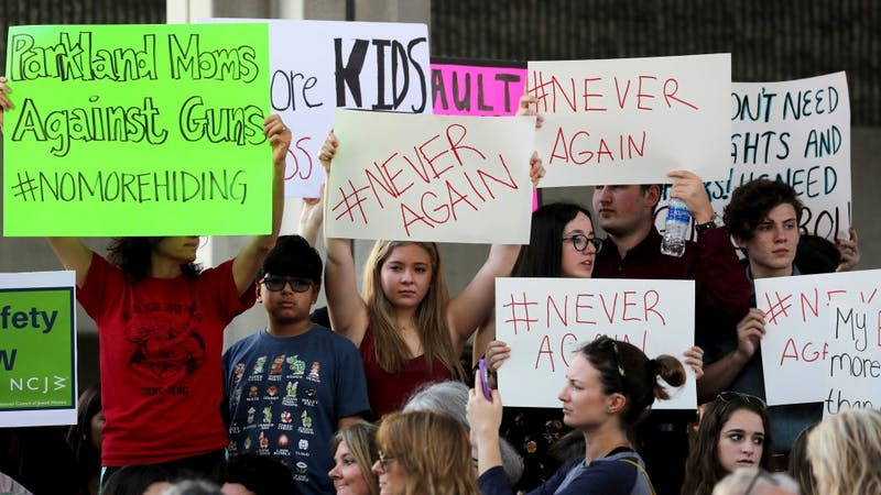 Protesters attend a rally at the Federal Courthouse in Fort Lauderdale, Florida, to demand government action on firearms, on Feb. 17, 2018. Their call to action is a response the massacre at Marjory Stoneman Douglas High School in Parkland, Florida. (Mike Stocker/Sun Sentinel/TNS)