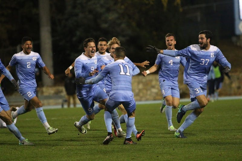 The North Carolina men's soccer team celebrates an overtime win over Providence in the 2016 NCAA Elite Eight.