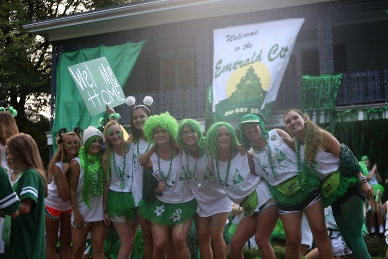 Members of Kappa Delta stand in front of their sorority house.