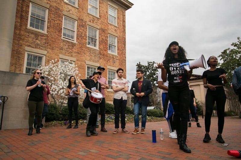 Students and faculty lead a crowd of several hundred during Wednesday's rally against fascism on UNC campus.