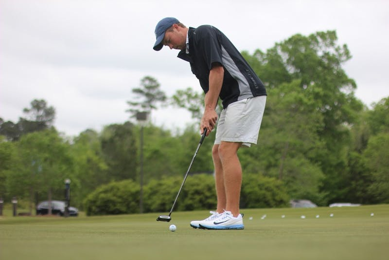 North Carolina's Ben Griffin takes a practice putt in the 2017 ACC Championships.