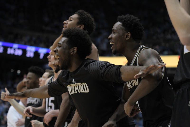 The Wofford men's basketball bench celebrates during a 79-75 upset victory over then-No. 5 North Carolina on Dec. 20 in the Smith Center.