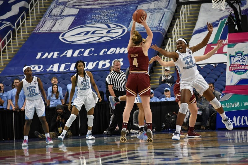 UNC center, Janelle Bailey (44) guards Boston College's Taylor Ortlepp (4) from making a 3 point shot.