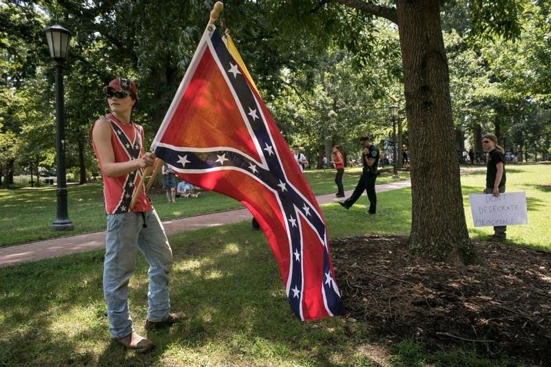 Seth Tanner from Franklinton, NC stands in front of Silent Sam in opposition to the sit-in on Aug 26.