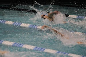 Senior Caroline Baldwin competes in Saturday's meet at Koury Natatorium.