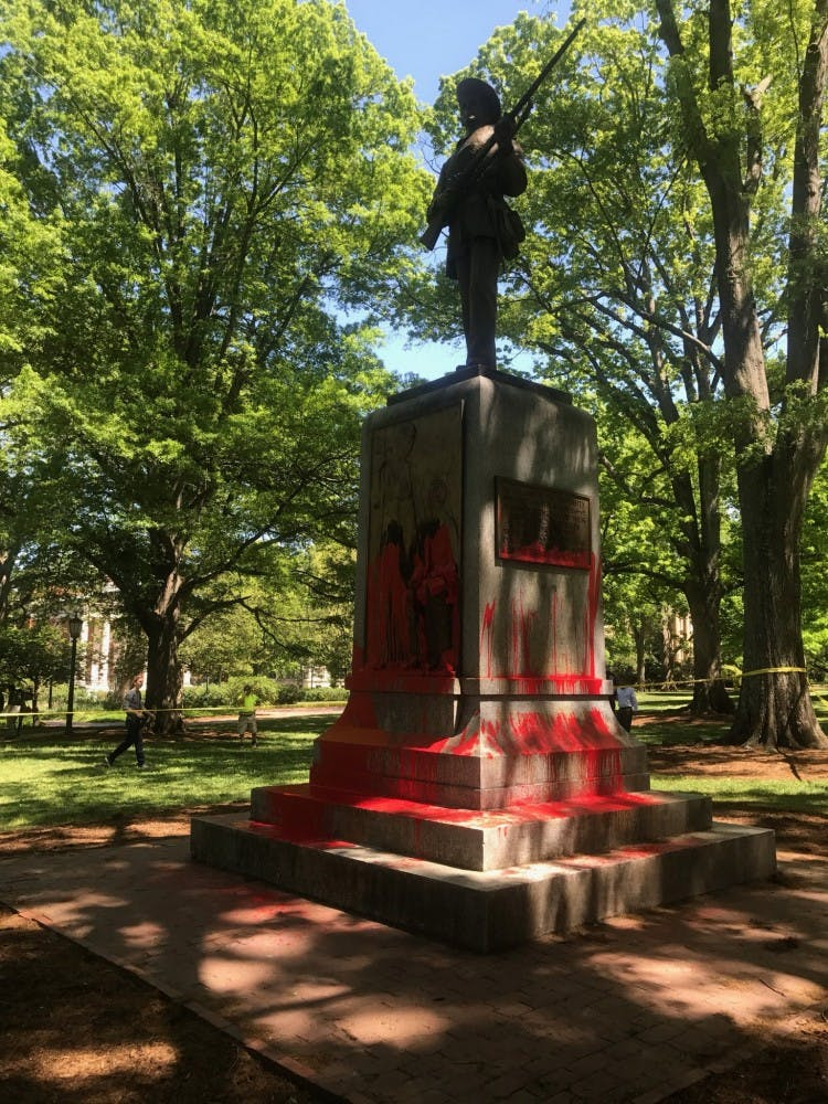 Silent Sam painted red, protester arrested