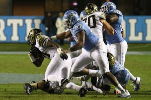 Defensive lineman Jalen Dalton (97) makes a tackle in a 2015 game against Wake Forest.