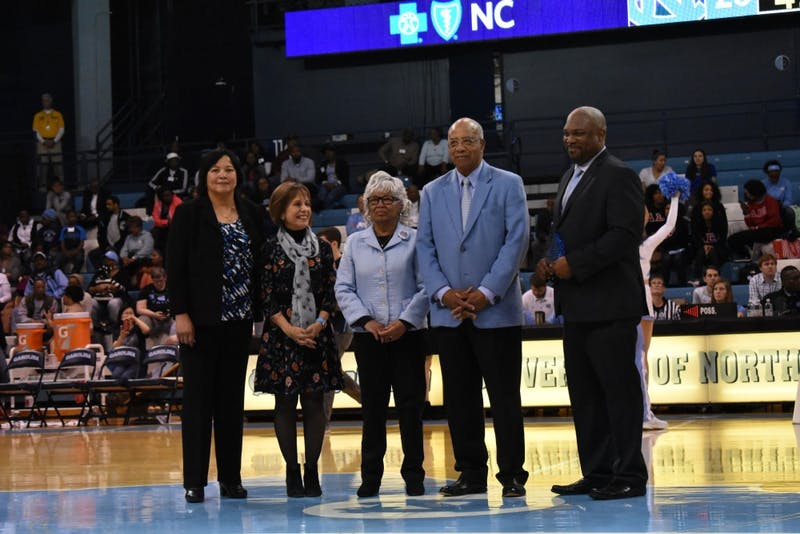Howard Lee (second from right) is honored during a Black History Month celebration on Feb. 7 in Carmichael Arena.