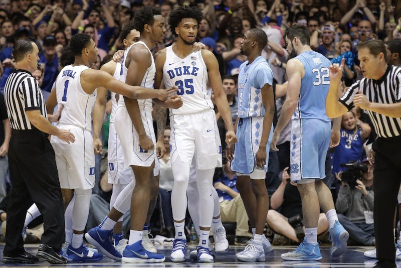 Duke forward Marvin Bagley III (35) is swarmed by teammates after an and-one against North Carolina on March 3 in Cameron Indoor Stadium.