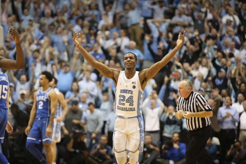 Guard Kenny Williams (24) celebrates in the final seconds of UNC's 82-78 win over Duke on Thursday night in the Smith Center.
