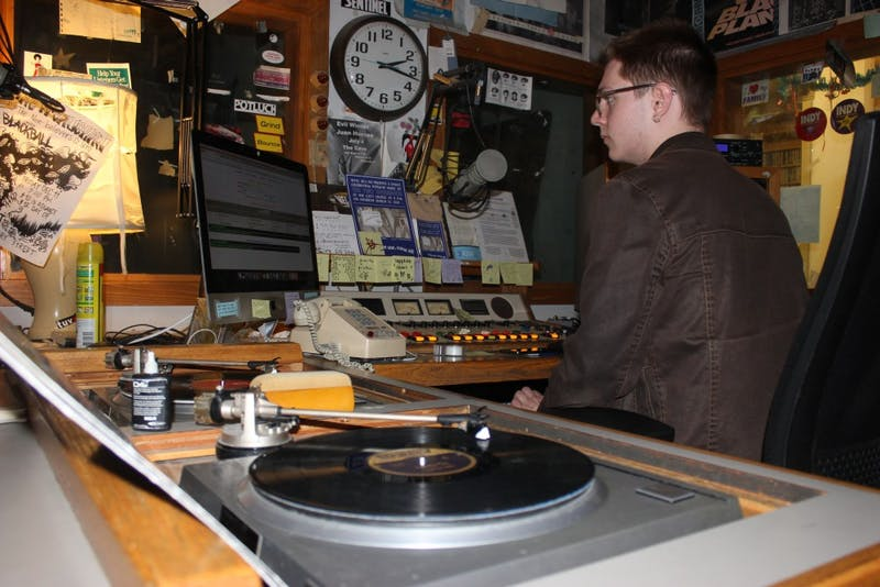 Student Holden Ruch DJ's the late night shift for WXYC, UNC's college radio station.