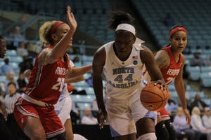 Forward Janelle Bailey (44) drives to the basket against Radford on Thursday night in Carmichael Arena.