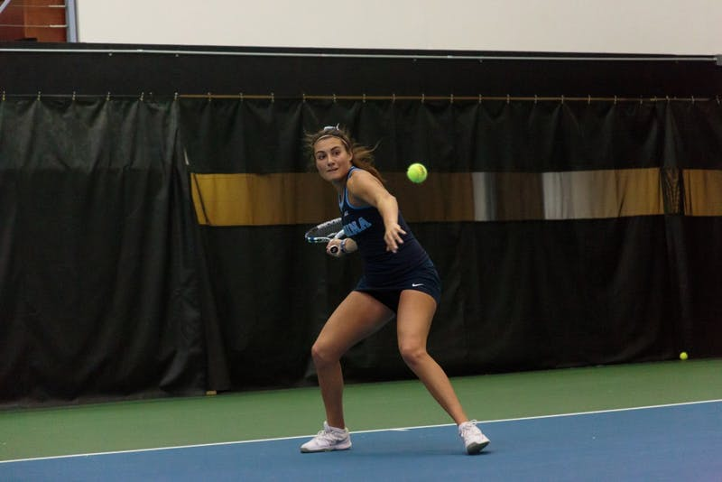 Alexa Graham winds up to hit the ball during a singles match against Georgia Tech on Saturday..