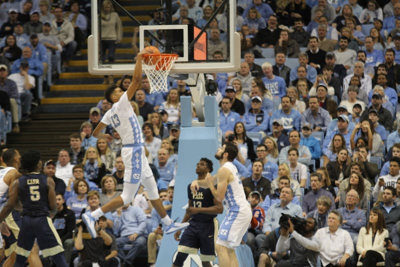 Guard Cameron Johnson (13) dunks against Pittsburgh on Feb. 3 in the Smith Center.