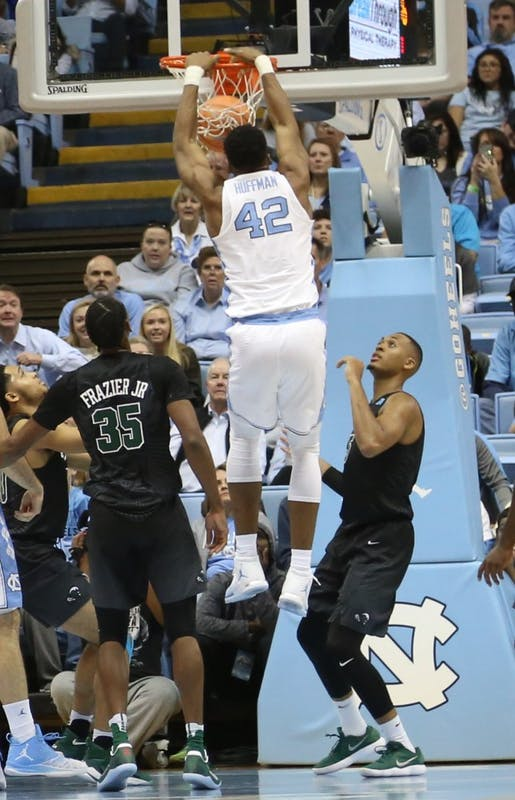 Forward Brandon Huffman (42) dunks against Tulane on Dec. 3 in the Smith Center.