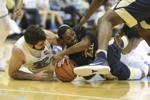 Forward Luke Maye (32) fights for possession of a loose ball against Pittsburgh on Feb. 3 in the Smith Center.