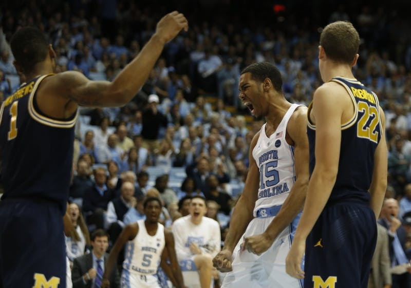 Forward Garrison Brooks (15) celebrates after a play during a game against Michigan on Nov. 29 in the Smith Center.