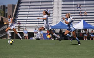 UNC forward Sydney Spruill (2) chases after the ball against UNC-Wilmington on Sunday.