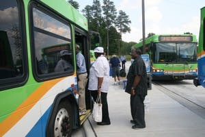 Residents board a Triangle Transit Authority bus going to downtown Durham. All GoTransit buses will be free to ride Thursday.