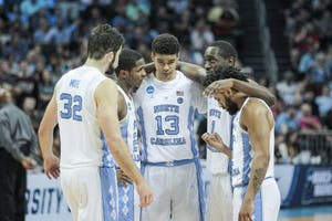 North Carolina's starting five huddles during a loss to Texas A&M in the second round of the NCAA Tournament on March 18 in Charlotte.