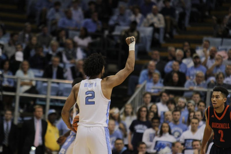 Guard Joel Berry II (2) raises his fist to start an offensive possession against Bucknell on Nov. 15 in the Smith Center.
