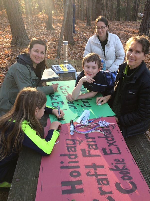 Homeschooling parents and children decorated a sign for December's Holiday Craft Fair and Cookie Exchange. Photo courtesy of Emily Brewer.